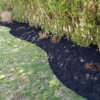 Black mulch in long garden
